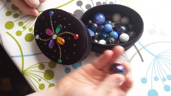 Open box of coloured marbles